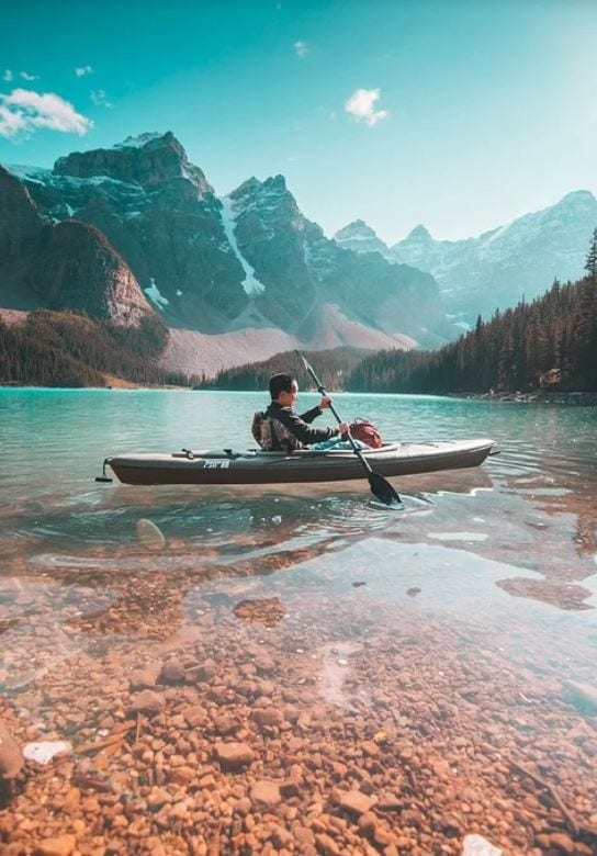Young kid kayaking in Canada