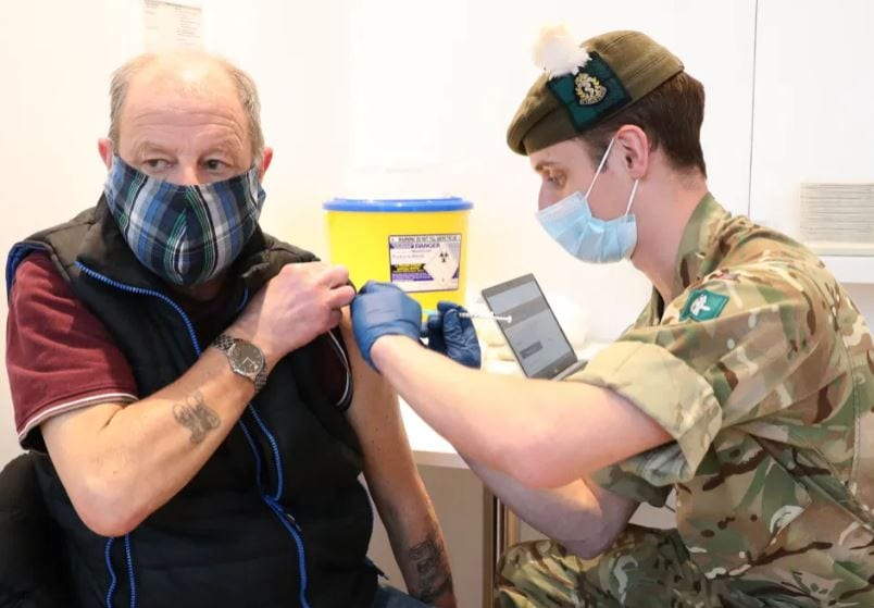 Soldier vaccinating a citizen in the U.K
