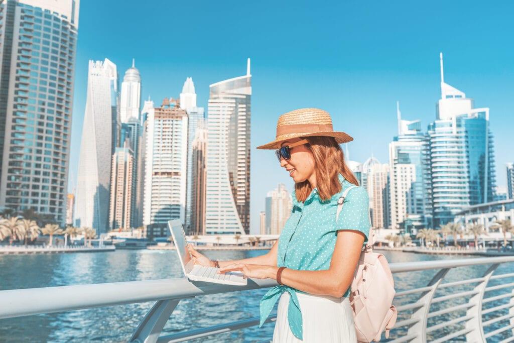 digital nomad working on laptop at Dubai marina