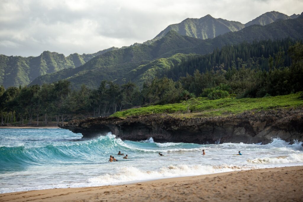 surfers in northern hawaii